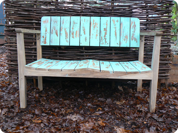 hand made wooden benches with blue distressed look paint